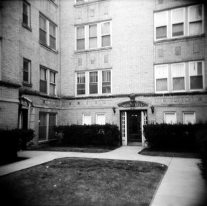 The entrance to Henry Sio's basement apartment is seen on the far left of this contemporary image. The windows seen on the bottom corner of this shot were Sio's apartment. He was found dead from a self-inflicted bullet to the brain in the den inside. (Photograph by The Comtesse DeSpair.)