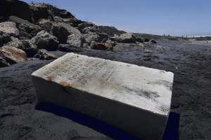 Tombstone Washes Up on Beach